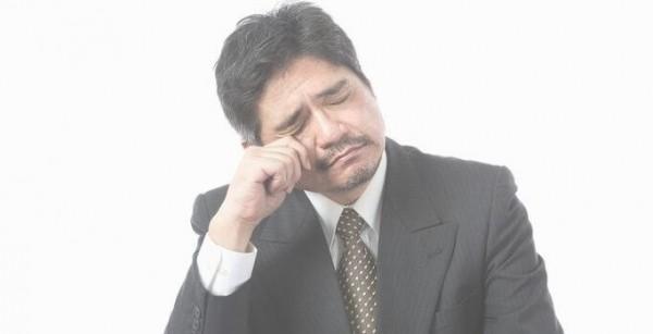 疲れている中年男性