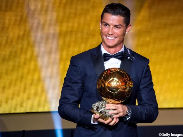 ZURICH, SWITZERLAND - JANUARY 12: Cristiano Ronaldo of Portugal and Real Madrid receives the 2014 FIFA Ballon d'Or award for the player of the year during the FIFA Ballon d'Or Gala 2014 at the Kongresshaus on January 12, 2015 in Zurich, Switzerland. (Phot